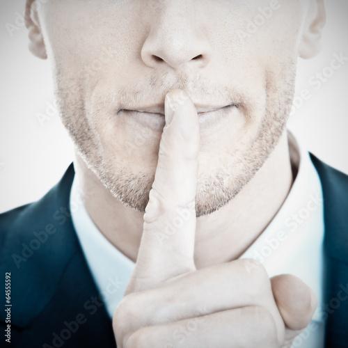 canvas print picture Top Secret - Geschäftsmann mit Finger vor Mund