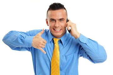 Happy man at blue shirt talks at mobile phone