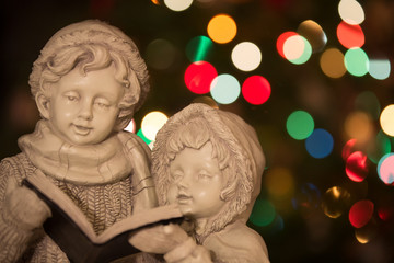 Statue of Boy and Girl Carolers with Christmas Lights