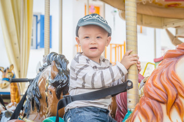 Children play carousel horse