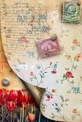 Vintage postcard with stamps and tulips field