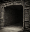 Entrance tunnel of old brick. Dark arch. Black white. - 64559720
