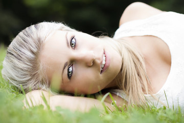Beautiful perfect woman lying on the grass