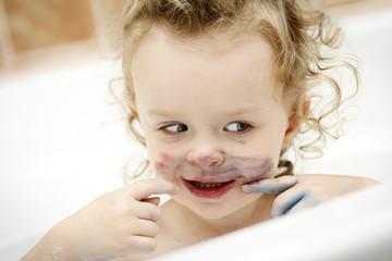 Little dirty child having a bath