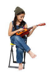 Little girl playing ukulele on white background
