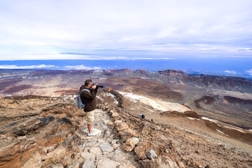 Man taking picture near volcano Teide