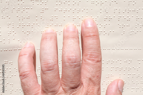 canvas print picture Blind reading text in braille language