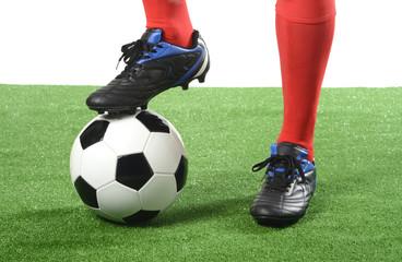 Balón y jugador de fútbol