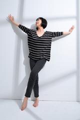 Full body beautiful woman yoga posing on a studio background