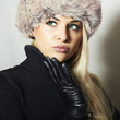 Woman in Fur Hat. Beautiful Blond Girl in Black Leather Gloves