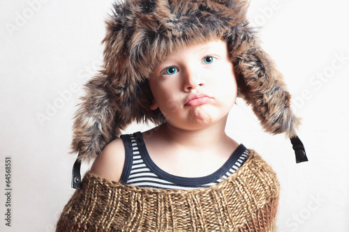 child in fur Hat.fashion winter style.little funny boy