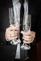groom - bridegroom is standing there with a  empty glasses