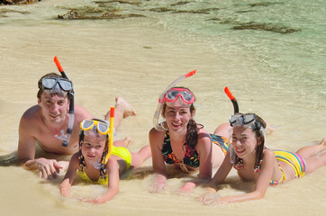 Happy family in snorkels on having fun on vacation