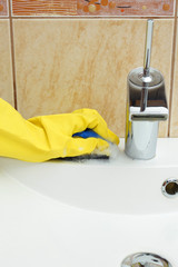 Cleaning sink in bathroom