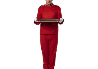 Red suit bellboy with tray isolated on white