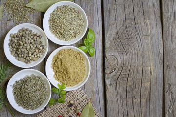 Herbs and dried spices on wooden board