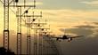 Big jet airplane landing on runway in sunset