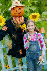 gardening - scarecrow and happy girl