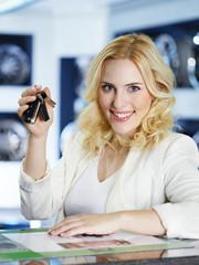 Female customer displays her car key