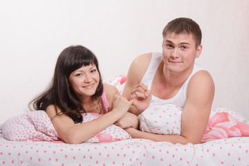 Lovers put up in bed after an argument