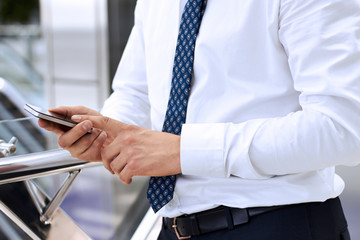Businessman holding the mobile  phone
