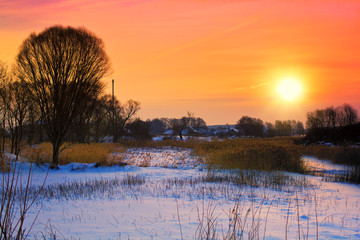 Winter snowy rural landscape in evening