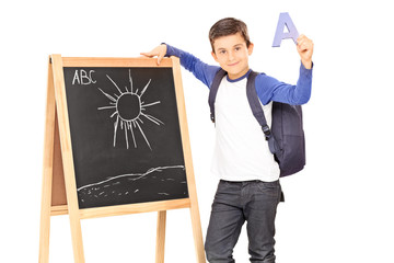 Schoolboy holding the letter a