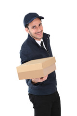 Smiling delivery man holding package towards camera
