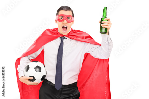 Superhero holding a football and cheering
