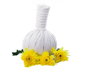 Herbal massage balls and yellow flowers isolated on white.
