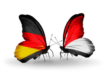 Two butterflies with flags Germany and Monaco or Indonesia