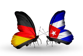 Two butterflies with flags Germany and Cuba