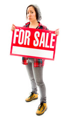 Worried saleswoman showing a for sale sign