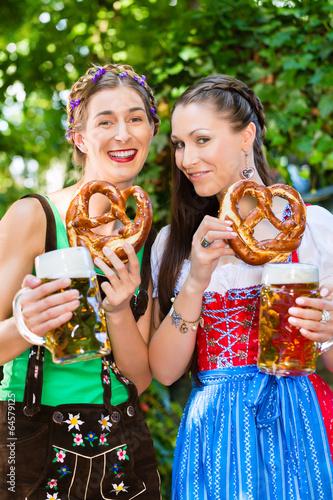 In Beer garden - friends drinking beer in bavaria
