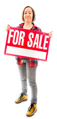 Saleswoman showing a for sale sign