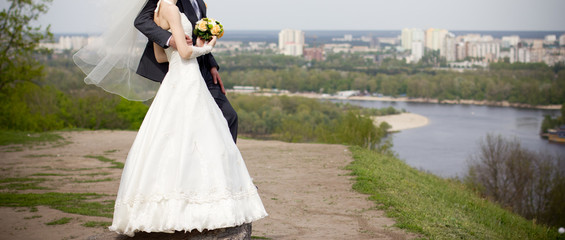 Married couple standing on top of hill