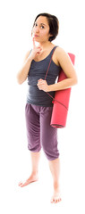 Young woman thinking with carrying exercise mat