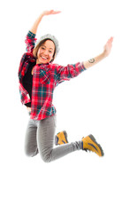 Young woman jumping in air and smiling