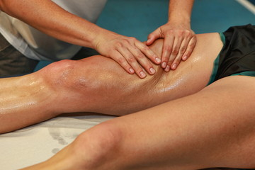 hands massaging athlete's thigh after running