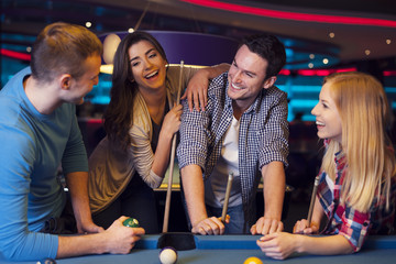 Funny time with friends in billiard club