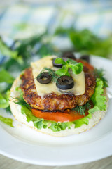 tasty hamburger with lettuce and tomato
