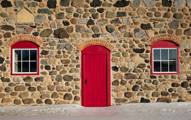 Old Stone Barn with Bright Red Door and Two Windows