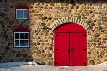 Old Stone Barn with Bright Red Door