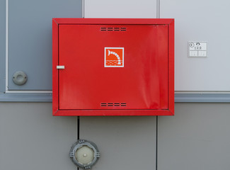 fireman tools box on factory wall