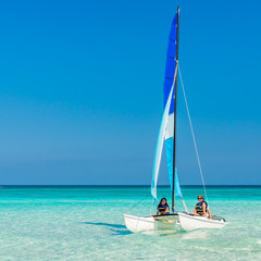 Girls sailing on a  catamaran at Varadero beach in Cuba