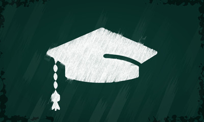 Graduation symbol tag sketched on a blackboard