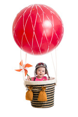 cheerful kid on hot air balloon