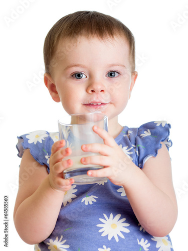Portrait of child drinking milk from glass