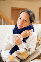 woman drinking hot tea at home
