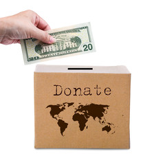 Human hand putting money in brown donate box with world map eart